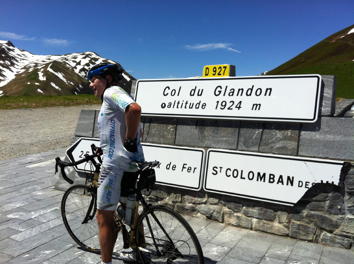 Cyclist resting at Col du Glandon in the French Alps