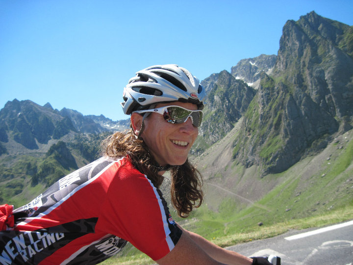 Woman cycling in the French Alps